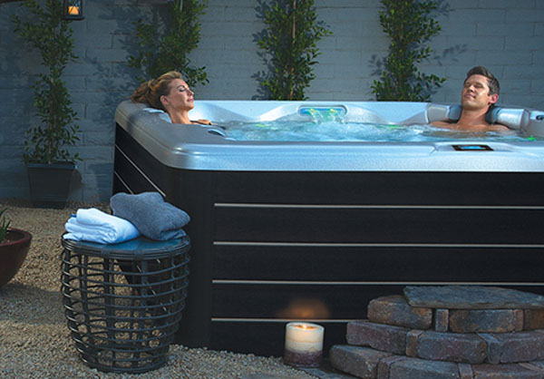 couple relaxing in outdoor hot tub
