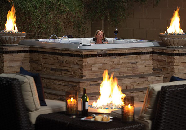 woman relaxing in outdoor hot tub