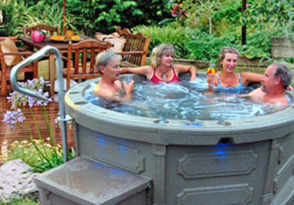couples enjoying outdoor hot tub